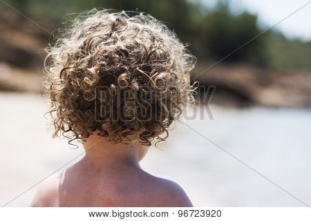 Curly Child Playing On Beach