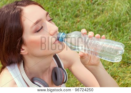 Nice young girl drinking water