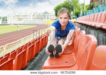 girl taking exercise outdoors