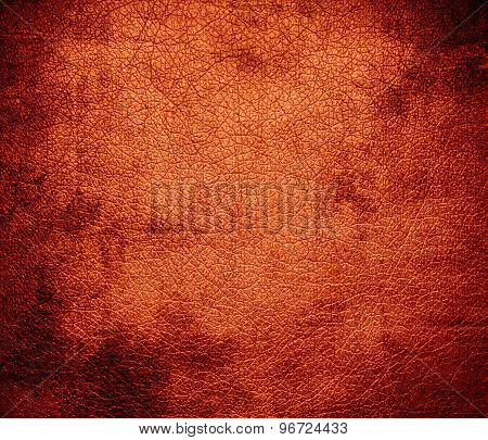 Grunge background of deep carrot orange leather texture