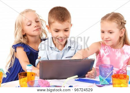 Playful children sitting with laptop