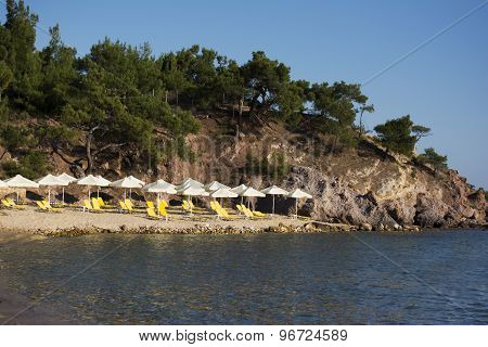 Rosos Gremos Beach With Yellow Sunbeds And Parasols