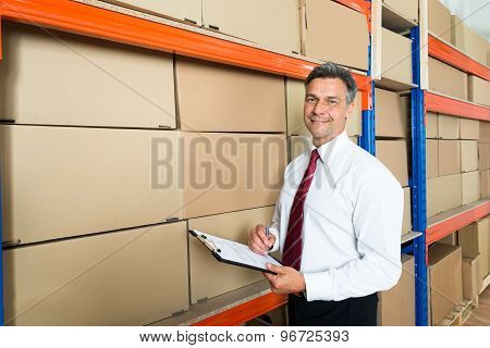Manager With Clipboard In Distribution Warehouse