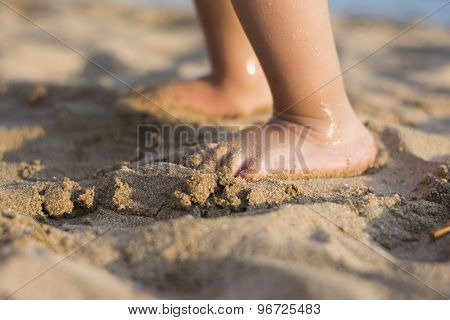 Barefoot Child In The Sand