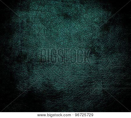 Grunge background of deep jungle green leather texture