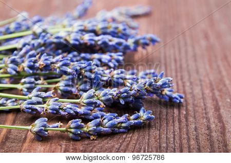 Lavender Flowers On The Wooden Table
