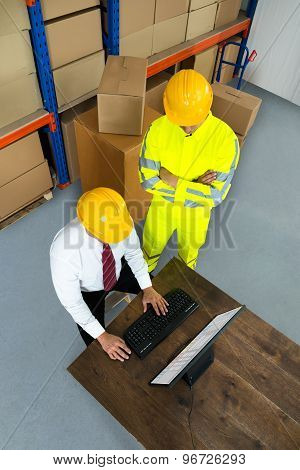 Warehouse Worker And Manager Using Computer