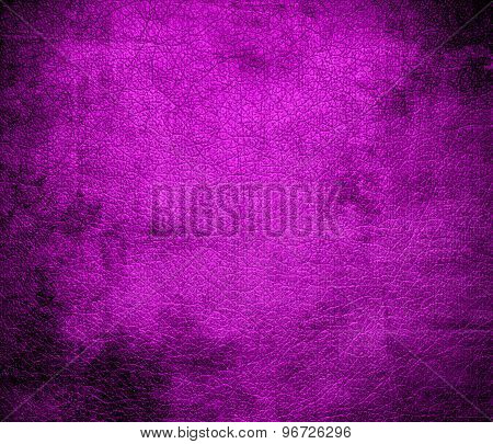 Grunge background of deep magenta leather texture