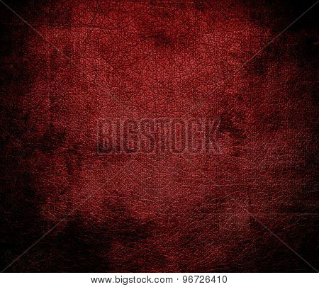 Grunge background of deep maroon leather texture