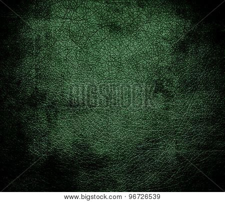 Grunge background of deep moss green leather texture