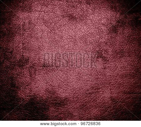 Grunge background of deep puce leather texture