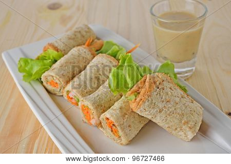 Sandwich Tuna Roll With Mayonnaise And Sesame Sauce On Plate