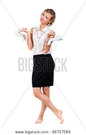 Angry upset young business woman with shoes standing isolated