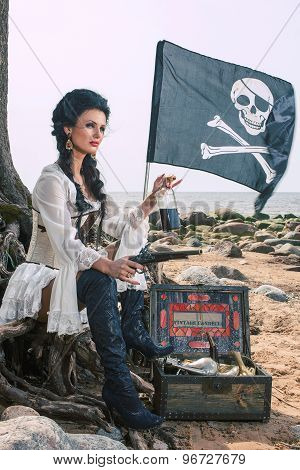 pirate woman sitting on the beach