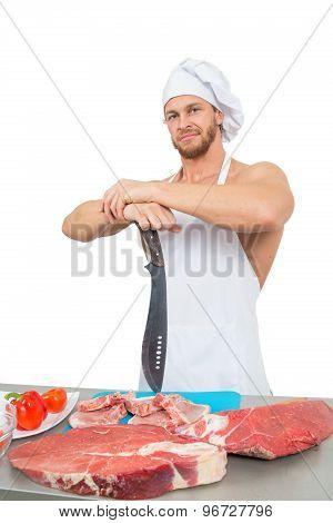 chef bodybuilder preparing large chunks of raw meat.