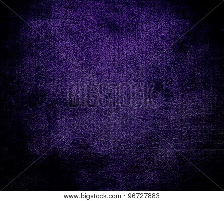 Grunge background of deep violet leather texture