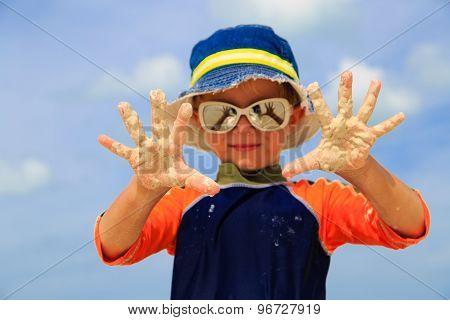 little boy having fun on beach vacation