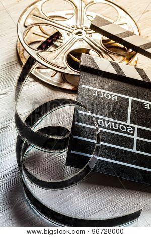 Film camera chalkboard and roll on wooden table