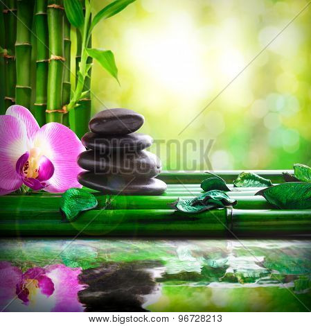 Stacked Stones On Bamboo Reflected In Water Massage And Relax