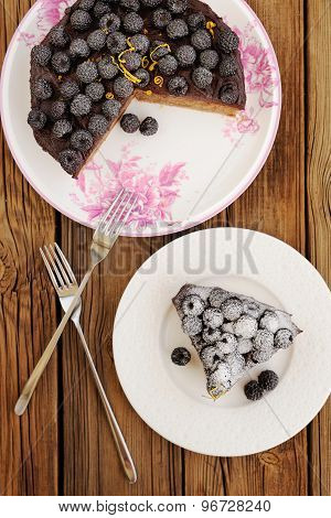 Delicious Blackberry Chocolate Pie With Cut Piece And Two Forks On Wooden Table