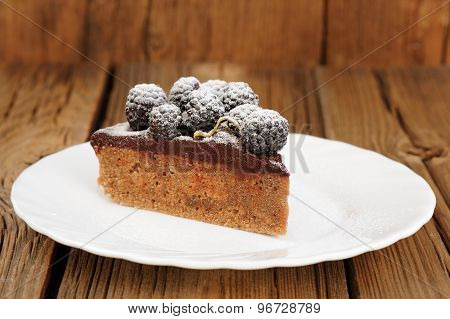 Piece Of Delicious Chocolate Pie With Ganache And Fresh Blackberries Decorated With Icing Sugar In W