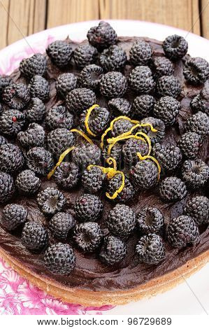 Tasty Homemade Chocolate Pie With Ganache, Decorated With Fresh Blackberries, Lemon Peel And Icing S