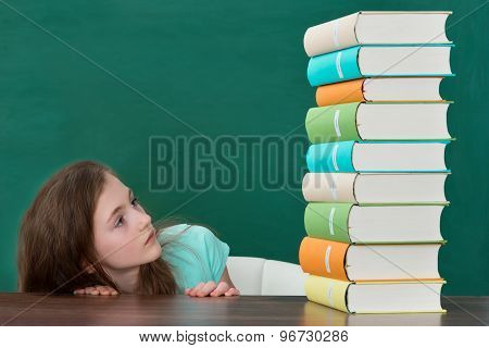 Afraid Girl Looking At Colorful Books