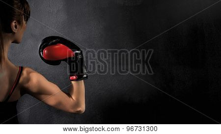 Boxer Woman Biceps with Red Gloves
