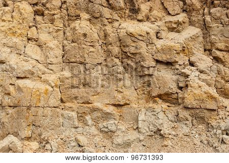 Wall of sand in sand pit close-up