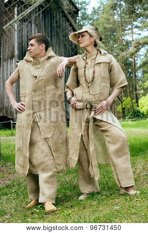 Ancient Medieval couple in original costumes from gunny sacking