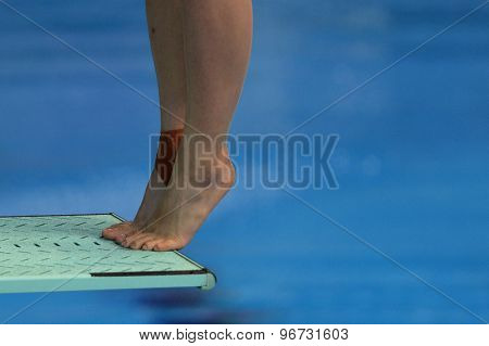 LONDON, GREAT BRITAIN - APRIL 26 2015: A close up of a female diver during the FINA/NVC Diving World Series at the London Aquatics Centre