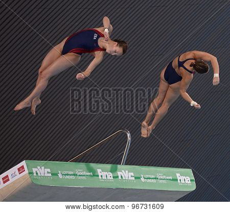 LONDON, GREAT BRITAIN - APRIL 25 2015: Amanda Burke and Samantha Pickens of The United States of America competing in the women's synchro 10m platform during the FINA/NVC Diving World Series