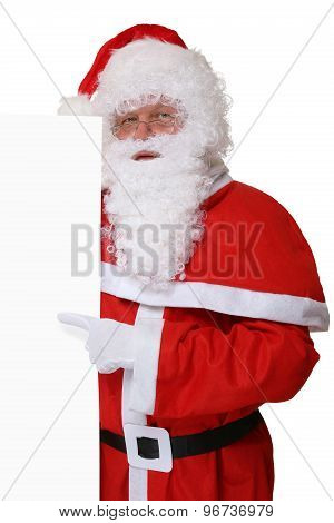 Santa Claus Pointing On Christmas At Empty Banner With Copyspace