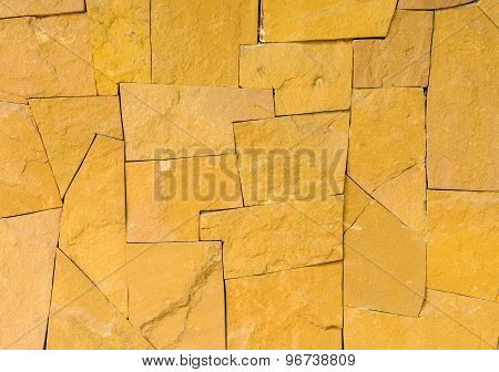 Texture Of Yellow Stone Wall
