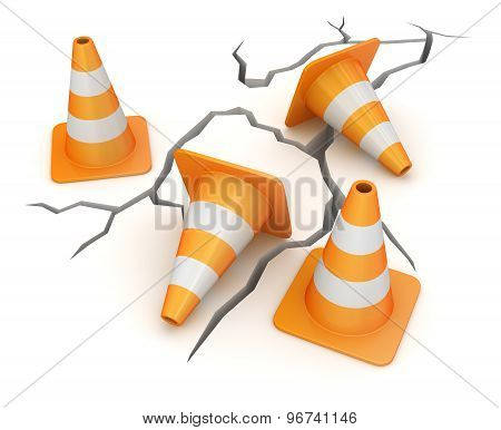 Cracked Ground And Traffic Cone