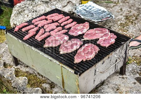 Raw Meat On Barbecue Grill With Coal
