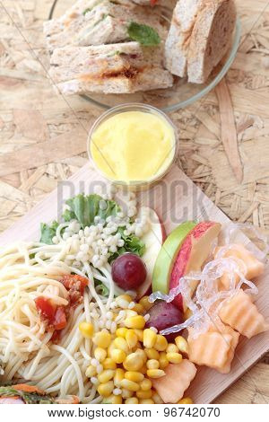 Pasta Spaghetti With Salad Mix Fruit And Bread Sandwich.