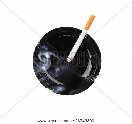 Black ashtray and smoking cigarette.