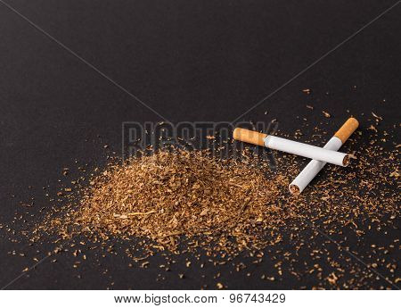 Heap of tobacco and cigarettes.