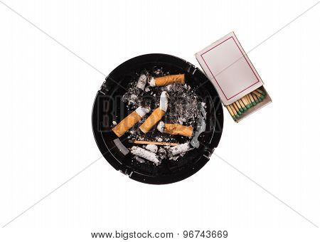 Black ashtray with cigarette butts.
