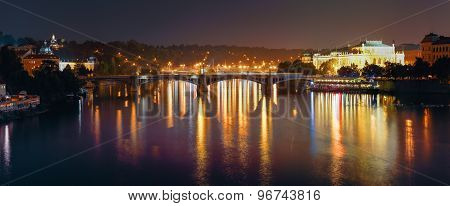 Panoramic Night View Of Vltava River And Manes Bridge