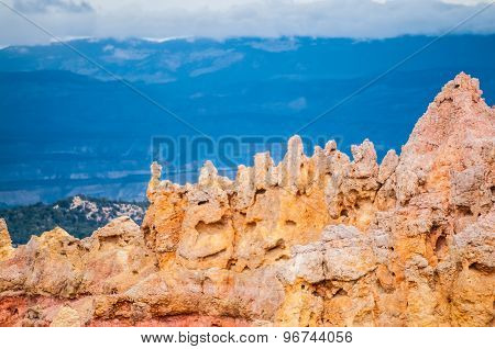 Bryce Canyon Hoodoos Close-up Against Blue Mountains Background Pattern