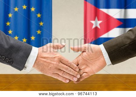 Representatives Of The Eu And Cuba Shake Hands