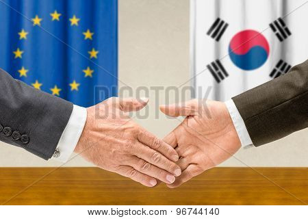 Representatives Of The Eu And South Korea Shake Hands