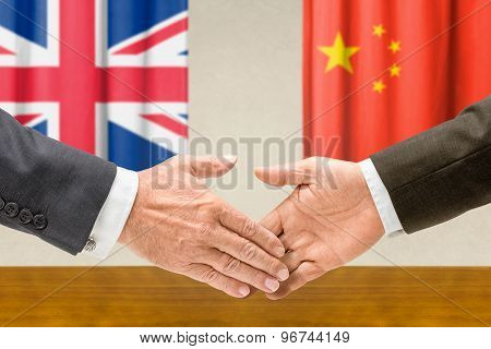 Representatives Of The Uk And China Shake Hands