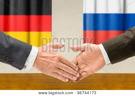 Representatives Of Germany And Russia Shake Hands