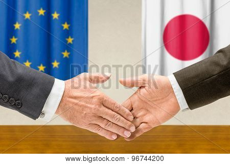 Representatives Of The Eu And Japan Shake Hands