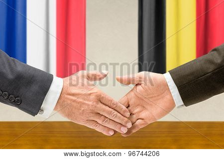 Representatives Of France And Belgium Shake Hands