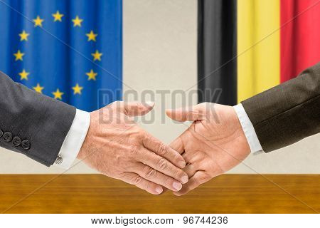 Representatives Of The Eu And Belgium Shake Hands
