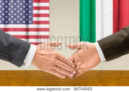 Representatives Of The Usa And Italy Shake Hands